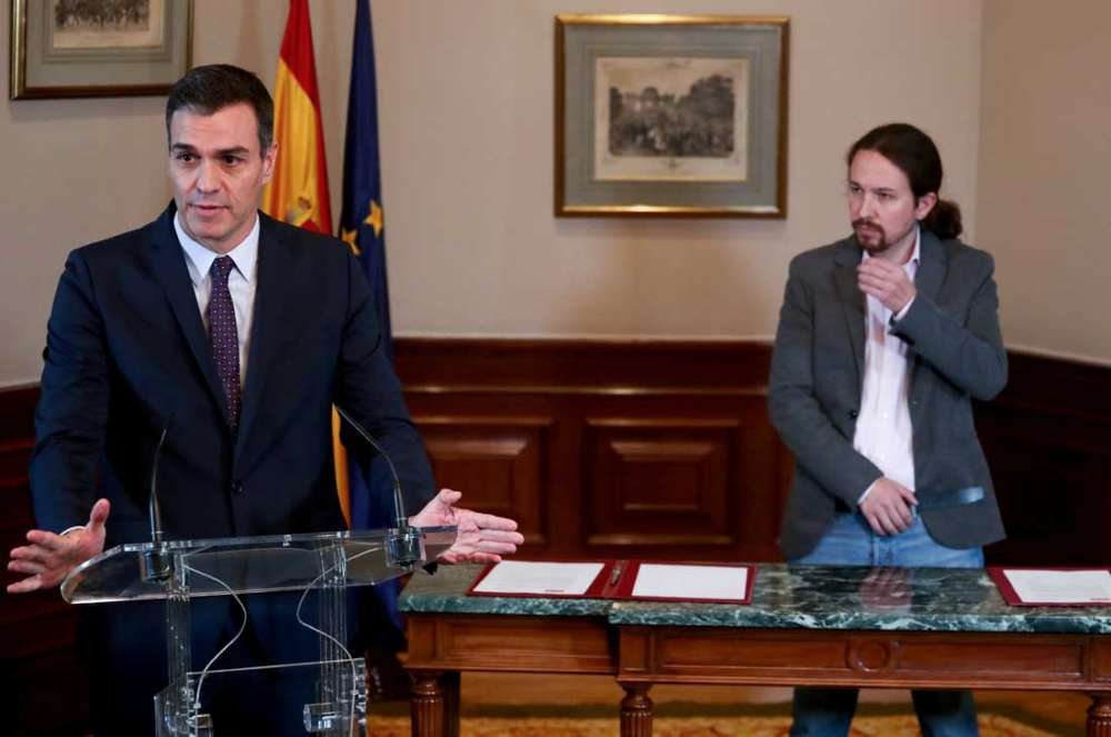 Spain's Socialists and Podemos reach preliminary coalition deal