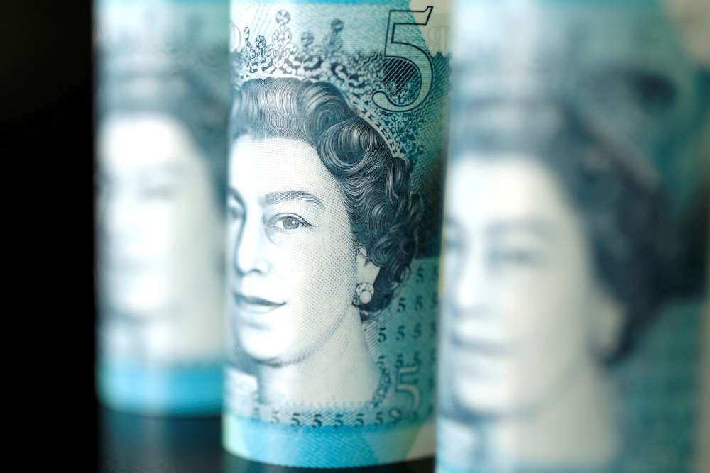 Sterling rises above $1.29 after strong UK jobs data