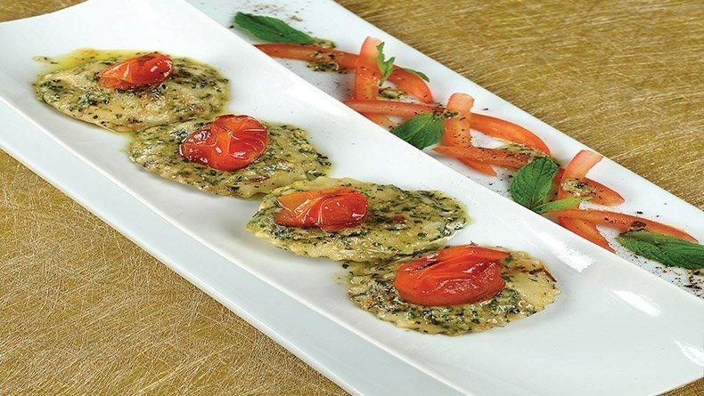 Traditional ravioli with mint pesto