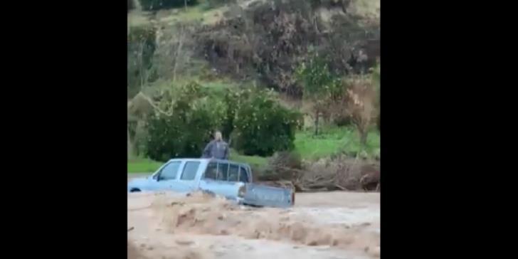 Fire services rescue driver stranded in stream