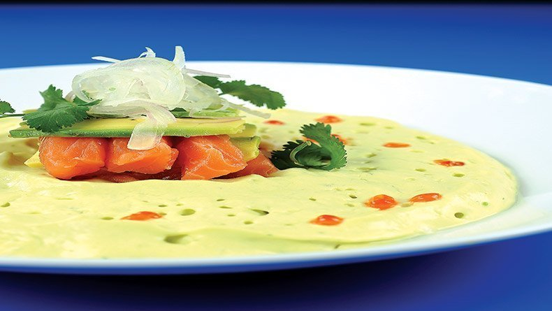 Cold guacamole soup with fresh salmon