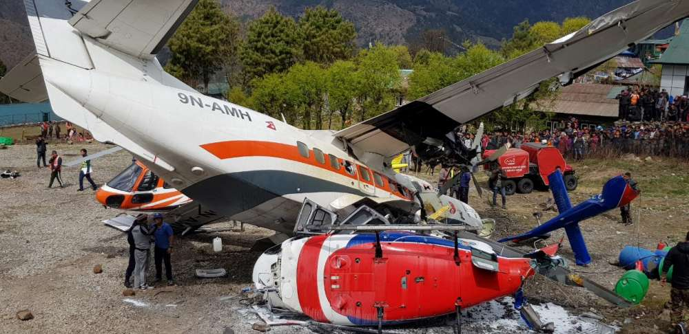 Nepal plane hits parked helicopter while taking off