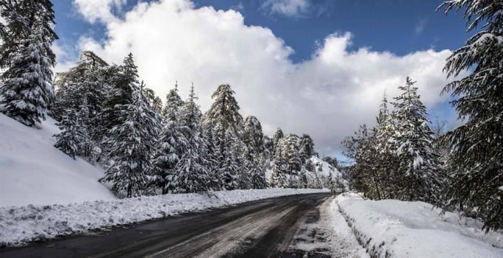Less chilly with local showers and light snowfall in mountains