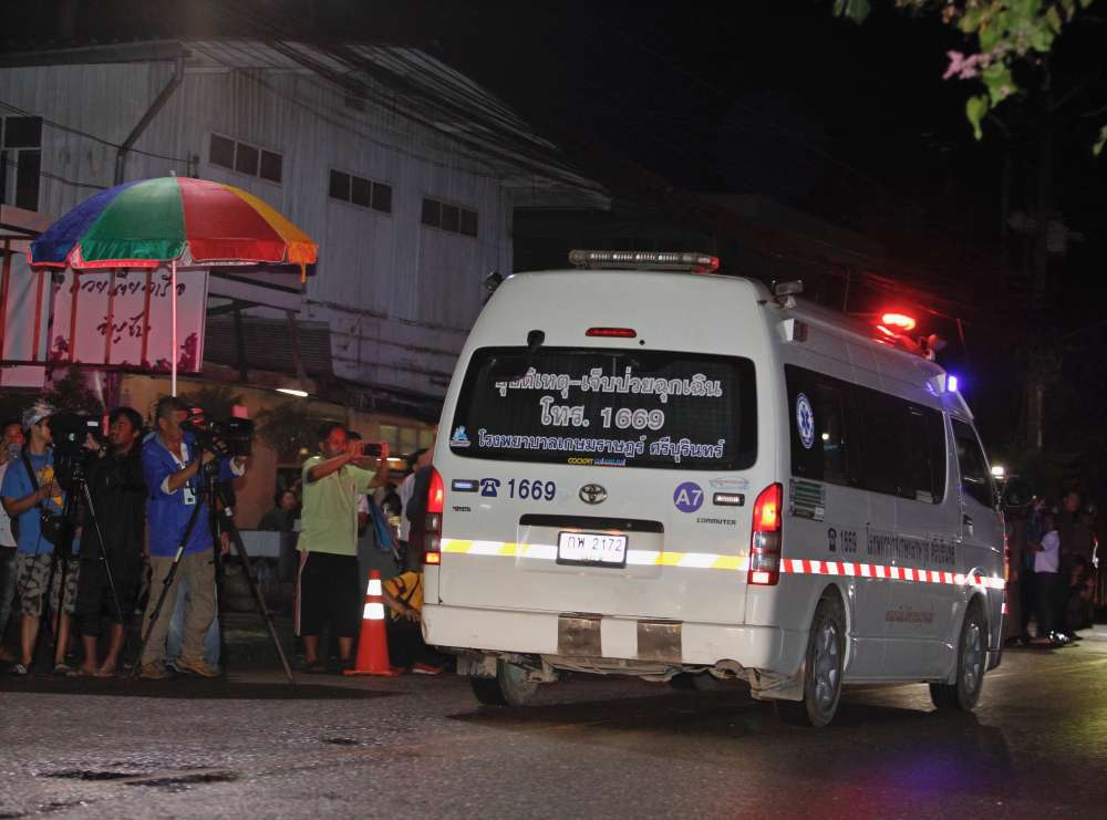 Four Thai boys saved from cave as rescue postponed until morning