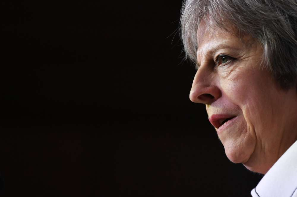 May wins support from divided government on Brexit plan