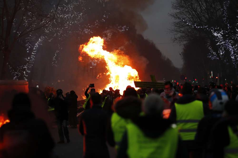 French 'yellow vests' rail against unrepentant Macron